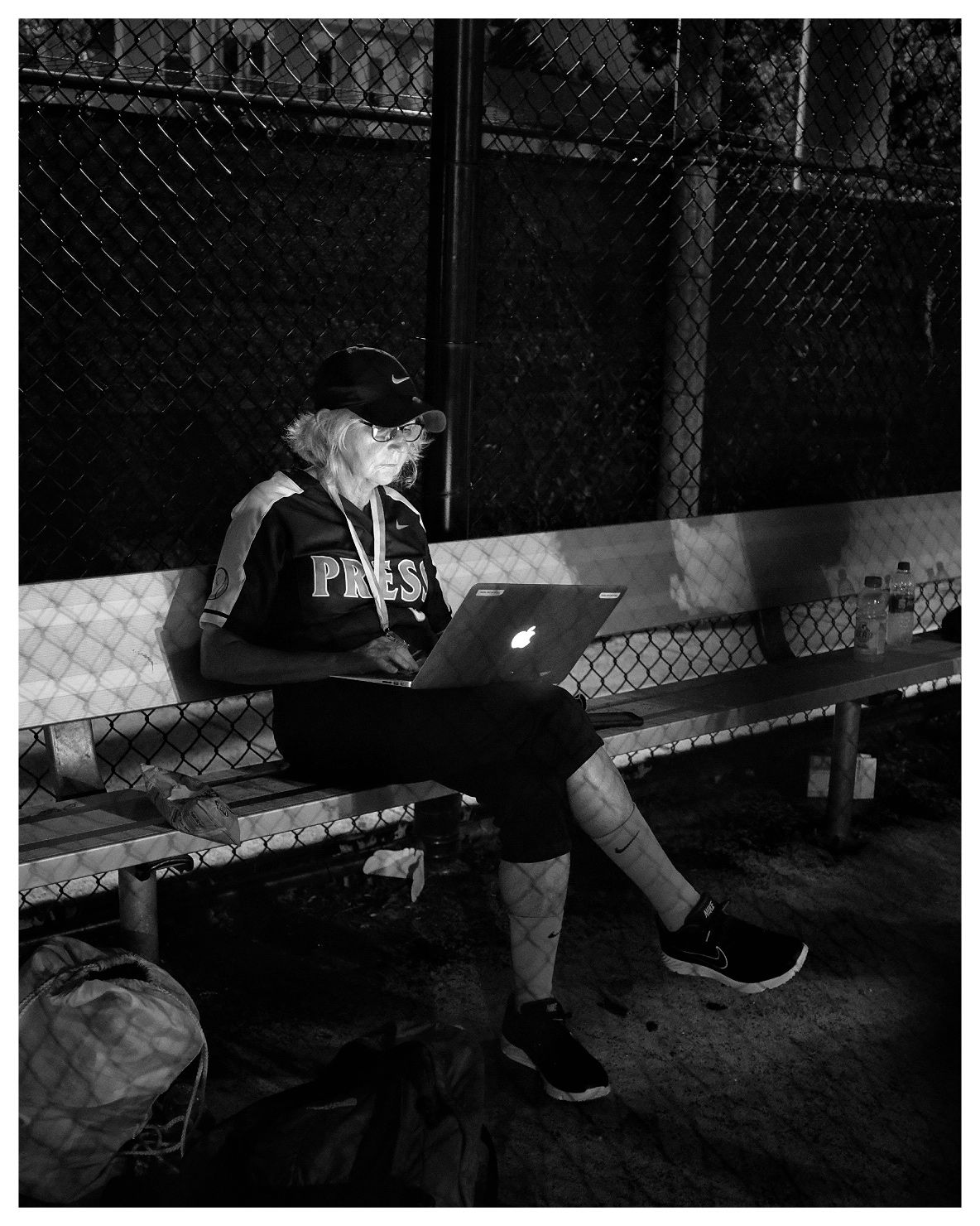 Lynn Sweet writes part of her column in the dugout