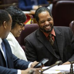 Ald. Anthony Beale (9th) laughs with Alds. Michelle Harris (8th) and Gregory Mitchell (7th) during Mayor Lori Lightfoot's first Chicago City Council meeting at City Hall, Wednesday, May 29, 2019.