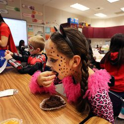 Stephanie eats a muffin in Christie Duong's third-grade class during the Breakfast in the Classroom program at Backman Elementary School in Salt Lake City on Friday, Oct. 28, 2016.