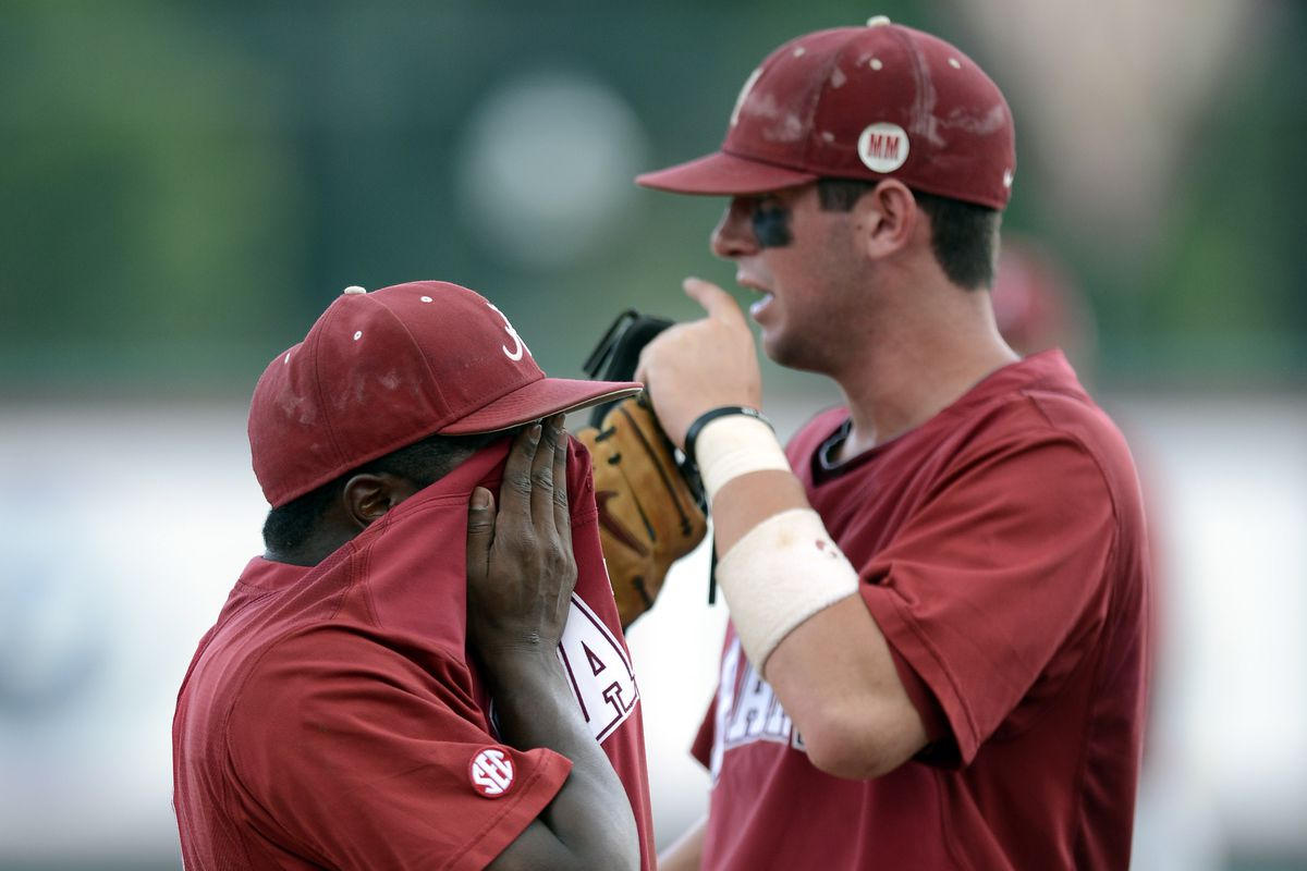 Short stop Mikey White (right) is the leader of the Crimson Tide this season