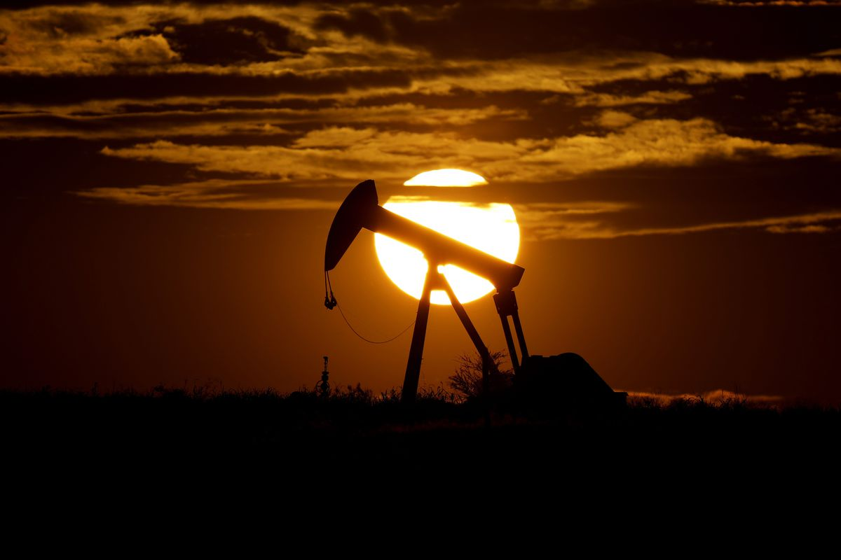 In this Wednesday, April 8, 2020, file photo, the sun sets behind an idle pump jack near Karnes City, USA.