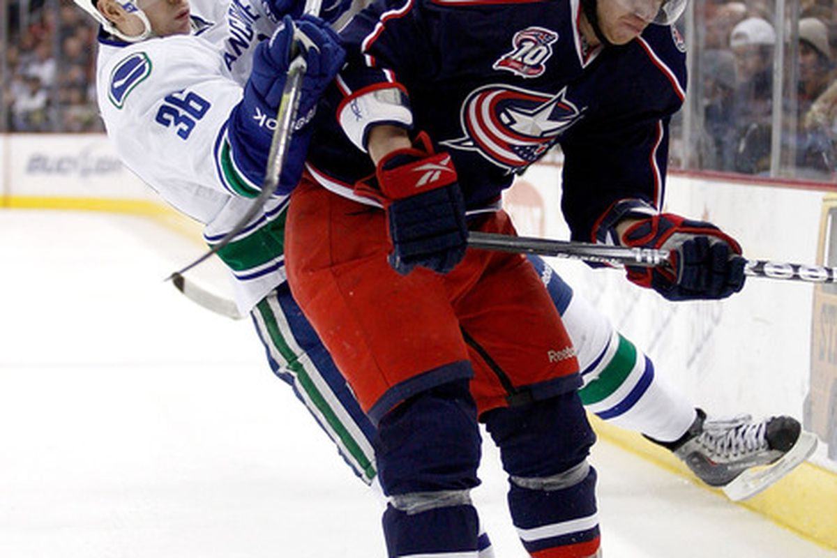 COLUMBUS OH - DECEMBER 23:  Jakub Voracek #93 of the Columbus Blue Jackets checks Jannik Hansen #36 of the Vancouver Canucks during the second period on December 23 2010 at Nationwide Arena in Columbus Ohio.  (Photo by John Grieshop/Getty Images)