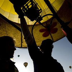 """Anneliese Gengel and Shannon White, right, both of Fort Collins, Colo., navigate the balloon """"Mountain Breeze"""" during the Ogden Valley Balloon Festival in Weber County on Friday. The 15th annual event runs through Sunday in Eden. Each evening at the festival field there will be a live concert with BBQ dinner offered for purchase. The popular """"Balloon Glow"""" will take place Saturday evening at dusk"""