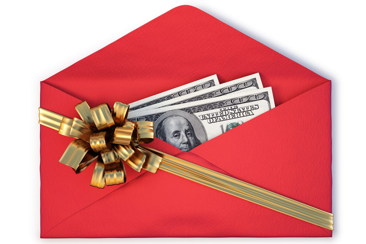 An open red envelope. In the envelope are one hundred dollar bills. There is a gold bow on the outside of the envelope.