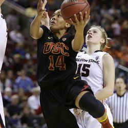 Southern California's Ariya Crook (14) drives the lane in front of Oregon States's Jamie Weisner in the second half of the Pac-12 NCAA college championship basketball game Sunday, March 9, 2014, in Seattle.  USC won 71-62. (AP Photo/Elaine Thompson)