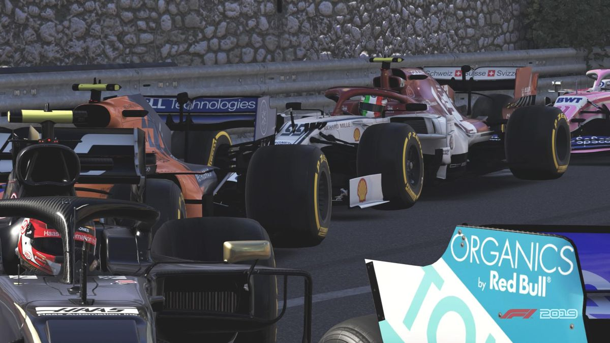 The field queued up through the infamous Loews Hotel hairpin turn at Monaco in F1 2019.