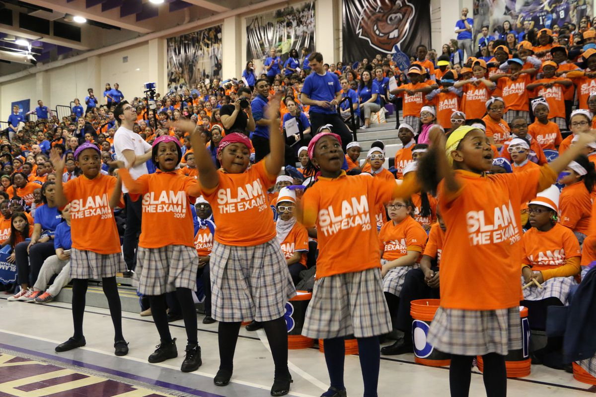 """A group of students performed at Success Academy's """"slam the exam"""" rally."""