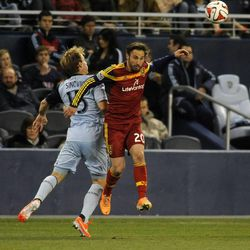 Real Salt Lake's Ned Grabavoy heads the ball away from Sporting KC's Seth Sinovic during a game at Sporting Park in Kansas City, Kan., on Saturday, April 5, 2014.