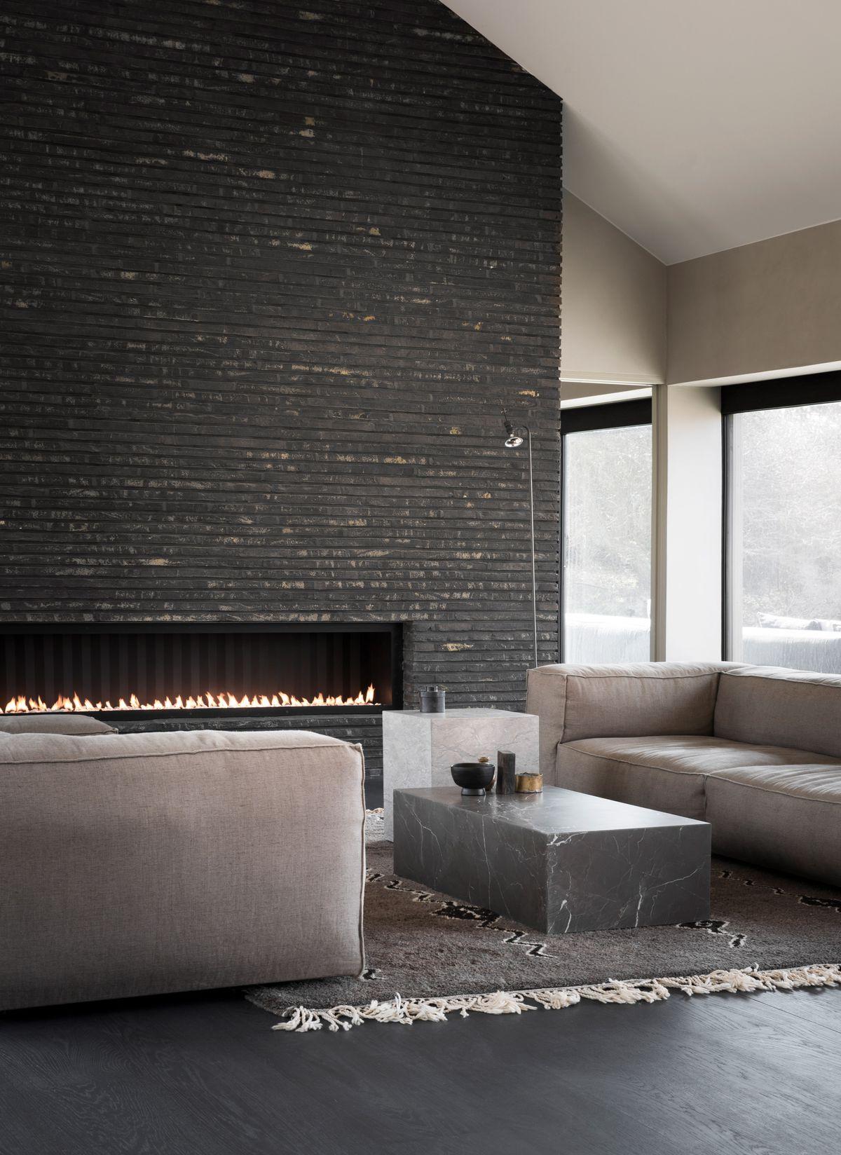 Black brick fireplace with sofa
