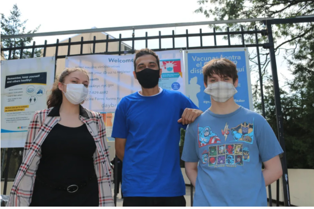 Ruby Muse, 14, (left) got vaccinated along with her stepfather Marcus Vazquez (center), and brother, 15-year-old Logan Muse (right.)