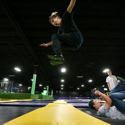 Jace Wigant, 13, top, jumps over Cooper Roy, 13, at Get Air Salt Lake in Murray on Friday, July 29, 2016.