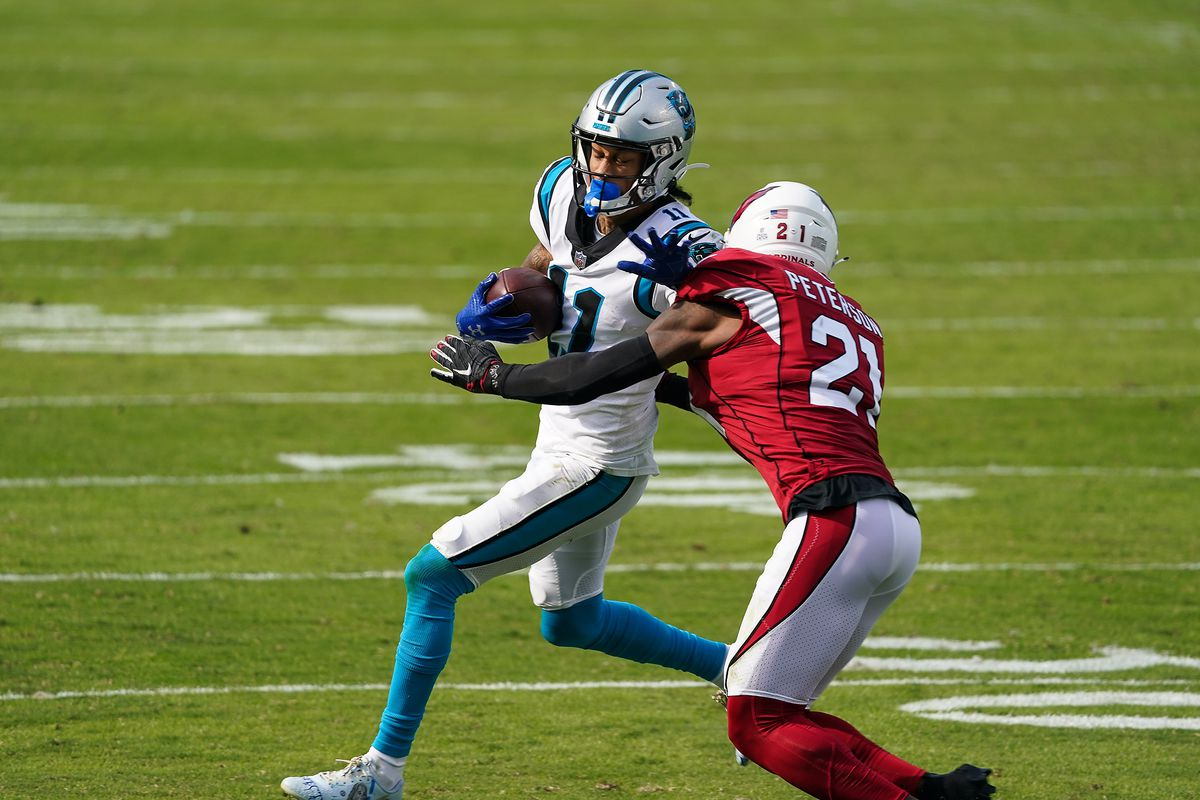 Carolina Panthers wide receiver Robby Anderson (11) runs against Arizona Cardinals cornerback Patrick Peterson (21) during the second half at Bank of America Stadium.