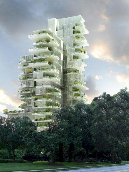 A tall skyscraper with multiple terraces that have plant life on them.
