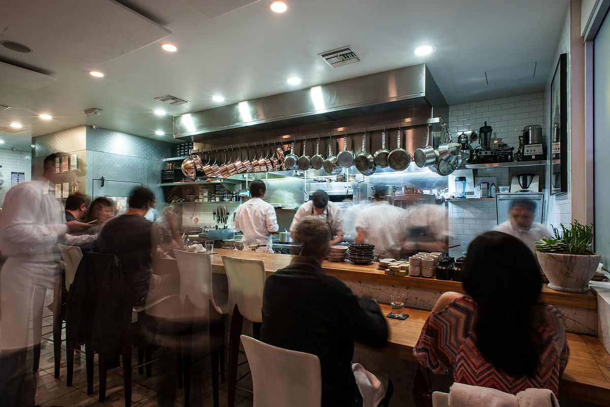 Diners and cooks inside of the small tasting menu restaurant Trois Mec in Los Angeles.