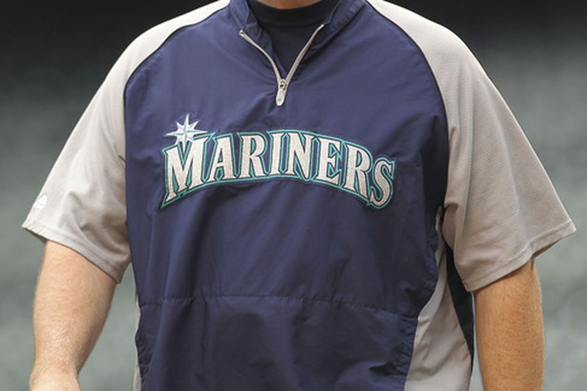 SEATTLE - Manager Eric Wedge #22 of the Seattle Mariners walks to the batting cage to watch players hit prior to the game against the Atlanta Braves at Safeco Field in Seattle, Washington. (Photo by Otto Greule Jr/Getty Images)