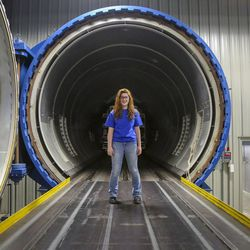 Katlynn Simpson, a senior at Clearfield High School and a member of the Utah Aerospace Pathways Program, stands  next to an industrialized oven used for heating composites at the Orbital ATK manufacturing facility in Clearfield on Thursday, April 20, 2017.