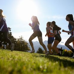 Runners compete in the 1A girls cross country championship at Sugar House Park in Salt Lake City on Wednesday, Oct. 23, 2019.