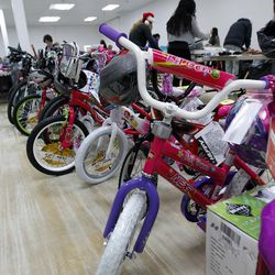 Children's bikes are lined up at the 13th annual Giving Tree program at Valley Fair Mall in West Valley City on Tuesday, Dec. 15, 2015. The program provides Christmas presents to 170 children from 61 low-income families in the city.