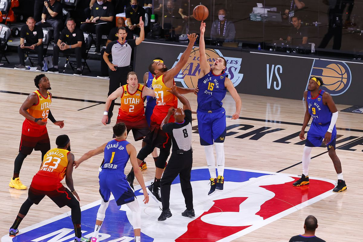 Nikola Jokic of the Denver Nuggets wins tip off over Rudy Gobert of the Utah Jazz during overtime at The Arena at ESPN Wide World Of Sports Complex on August 08, 2020 in Lake Buena Vista, Florida.