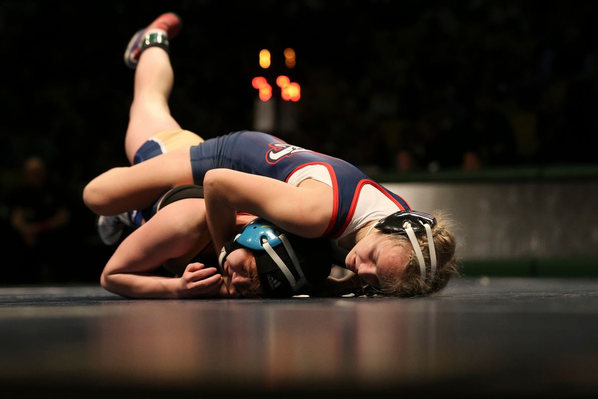 ALA's Sage Mortimer, top, and Kiersten Bush, of Bonneville, compete in the 113 lb. girls weight class at the Utah All-star Dual wrestling meet at the UCCU Center in Orem on Tuesday, Jan. 9, 2018.