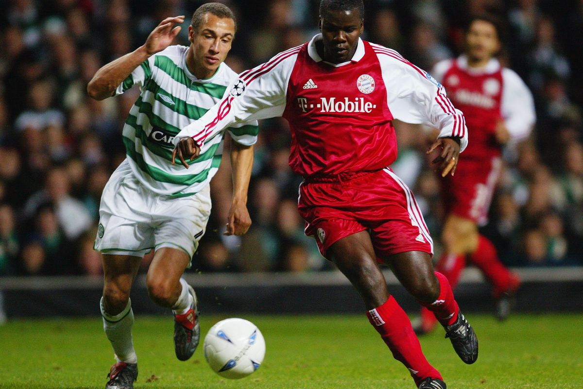 Henrik Larsson of Celtic and Samuel Kuffour of Bayern Munich tussle for the ball
