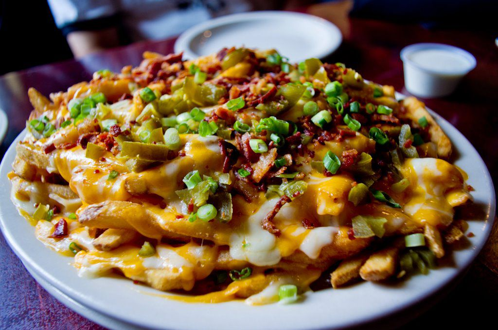 A pile of cheese fries pairs perfectly with football at Press Box Grill in Downtown