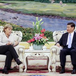 FILE - In this Aug. 30, 2012 file photo, Chinese Vice President Xi Jinping, right, listens to German Chancellor Angela Merkel during their meeting at the Great Hall of the People in Beijing, China. Where is President-in-waiting Xi Jinping? Chinese micro-bloggers and overseas websites have come up with all kinds of creative speculation as to why vice president Xi has gone unseen for more than a week. During that span, Xi canceled meetings in Beijing with visiting U.S. Secretary of State Hillary Clinton and Singapore Prime Minister Lee Hsien Loong. Monday, Sept. 10, it was the Danish prime minister's turn.