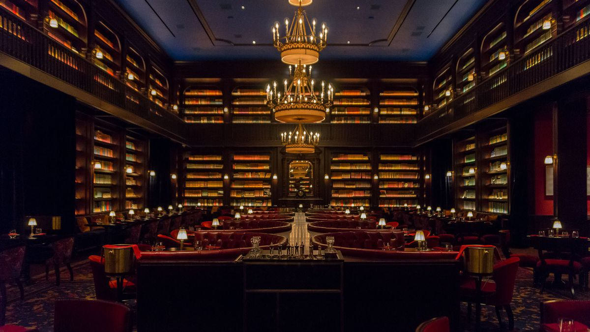 A handsome restaurant with 2,000 books lining the shelves