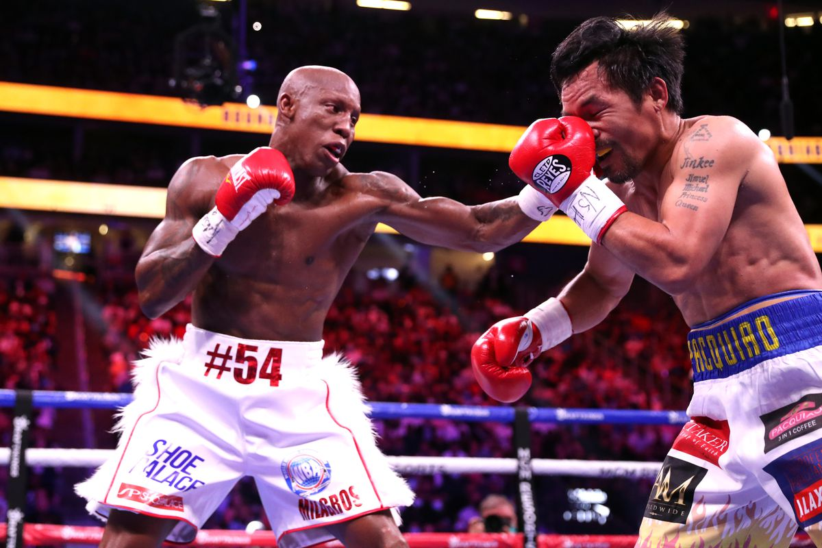 Manny Pacquiao eats a left hand from Yordenis Ugas.