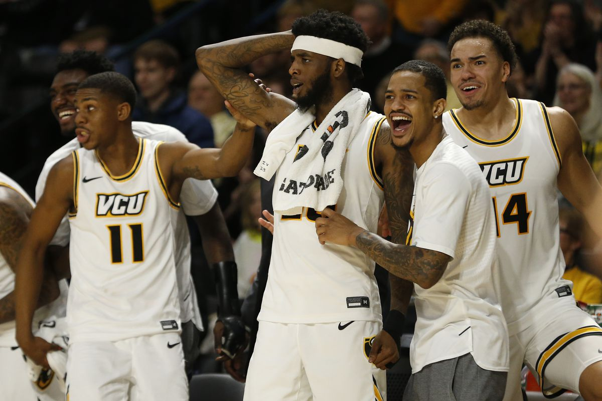 Virginia Commonwealth Rams players celebrate on the bench against the St. Bonaventure Bonnies in the second half at Stuart C. Siegel Center.