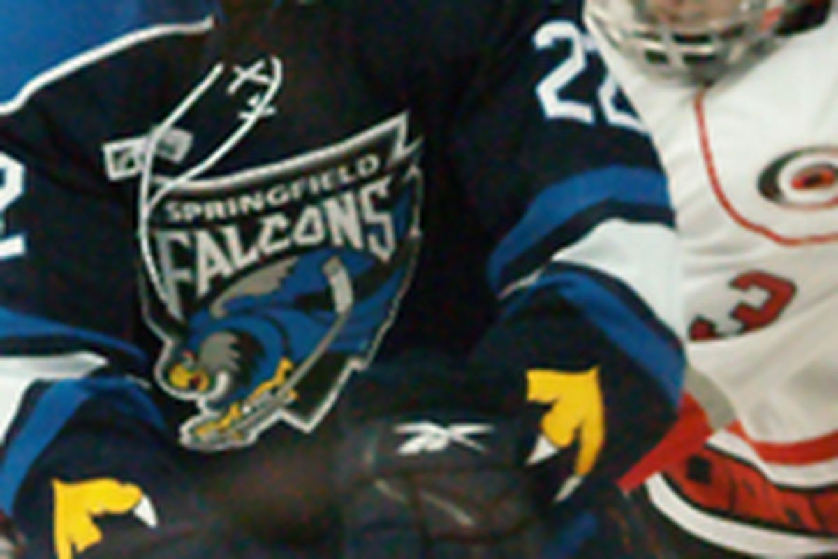 """Ryan O'Marra of the Springfield Falcons battles with Benn Olson of the Albany River Rats in an American Hockey League game on October 30, 2009. By <a href=""""http://www.flickr.com/photos/sandpiper214/"""">Jennifer Bock</a>."""