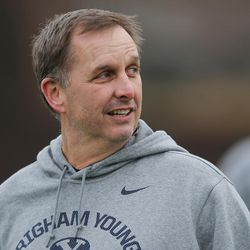 Brigham Young Cougars coach Ty Detmer watches players during practice in Provo on Tuesday, March 1, 2016.