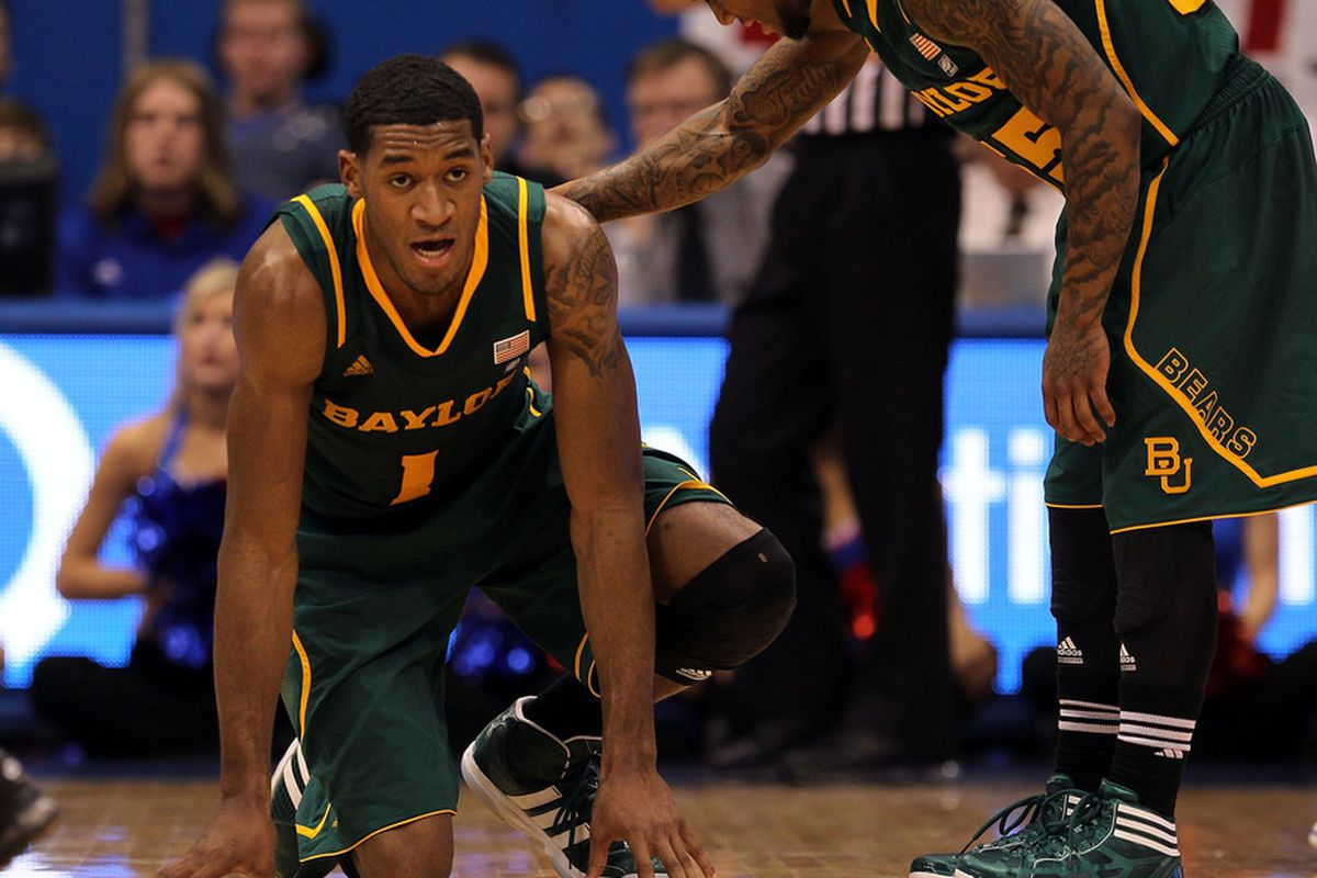 LAWRENCE, KS - JANUARY 16:  Perry Jones III #1 of the Baylor Bears falls to the ground during the game against the Kansas Jayhawks on January 16, 2012 at Allen Fieldhouse in Lawrence, Kansas.  (Photo by Jamie Squire/Getty Images)