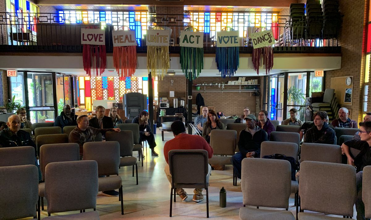 Allen Womble, justice team leader at Lighthouse Church of Chicago, leads the Lighthouse Foundation's Coalition of Allies for Racial Equity on Saturday, during Frazier's meeting with Center on Halsted leadership to discuss its security.