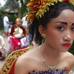 A Balinese princess waits to be carried to a cremation ceremony in Bali, Indonesia.