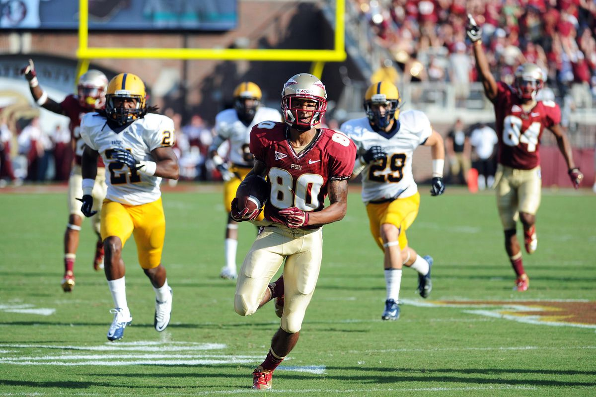 Sept 1, 2012;  Tallahassee, Florida, USA; Florida State Seminoles wide receiver Rashad Greene (80) returns a punt for a touchdown during the game against the Murray State Racers at Doak Campbell Stadium. Mandatory Credit: Melina Vastola-US PRESSWIRE