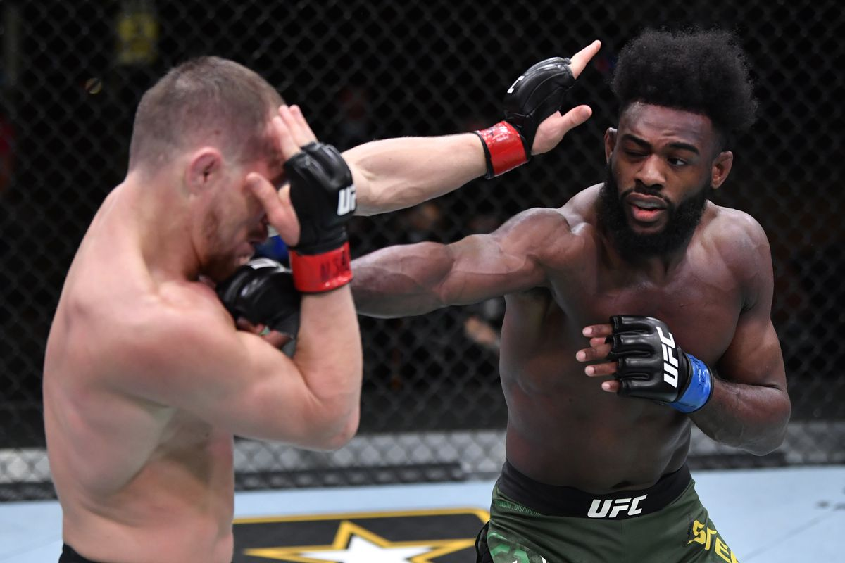 Aljamain Sterling and Petr Yan during their first meeting at UFC 259.