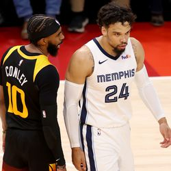 Utah Jazz guard Mike Conley (10) has a few words for Memphis Grizzlies forward Dillon Brooks (24) after Brooks was blocked by Utah Jazz center Rudy Gobert (27) as the Utah Jazz and Memphis Grizzlies play Game 2 of their NBA playoffs first round series at Vivint Arena in Salt Lake City on Wednesday, May 26, 2021. Utah won 141-129.