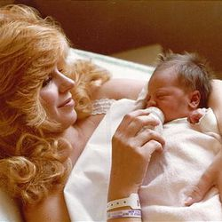 """Michele MacNeill holds her oldest daughter Rachel after giving birth on Oct. 11, 1979. Rachel says her mom was """"an angel walking among us."""""""