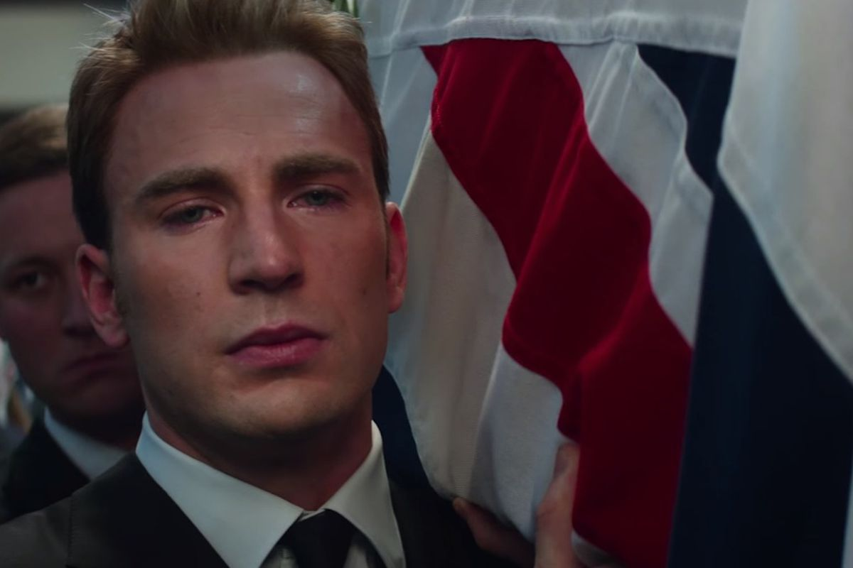 """Steve Rogers (Chris Evans) carries Peggy Carter's (Hayley Atwell) coffin in """"Captain America: Civil War."""""""