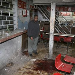 FILE - In this Monday, Oct. 24, 2011 file photo, pub-owner Charles Mwaura observes the bloodstained floor at the scene of a suspected grenade blast at his pub in downtown Nairobi, Kenya. The government-funded Kenya National Commission on Human Rights said Wednesday, Sept. 26, 2012 that a proposed law to help fight the increased threat of terrorism would give the state sweeping powers that can be abused to intimidate political opponents.