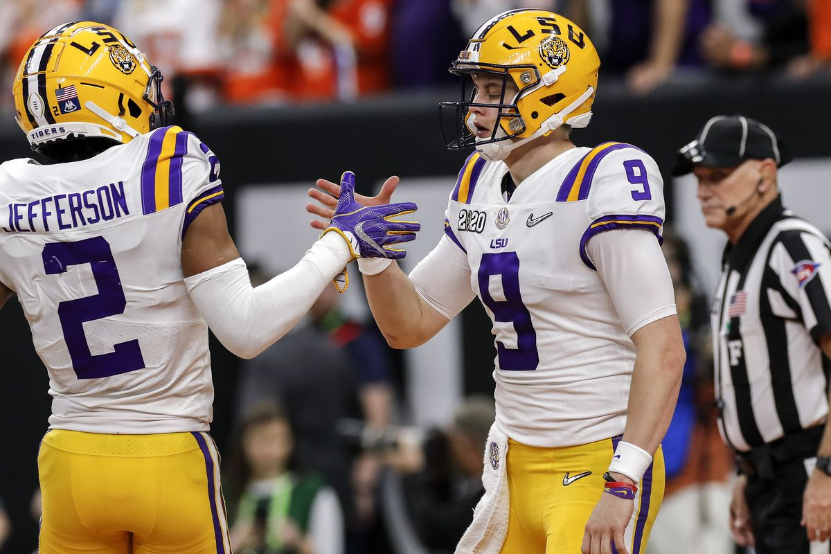 Quarterback Joe Burrow #9 celebrates with teammate Wide Receiver Justin Jefferson #2 of the LSU Tigers after scoring a touchdown during the College Football Playoff National Championship game against the Clemson Tigers at the Mercedes-Benz Superdome on January 13, 2020 in New Orleans, Louisiana. LSU defeated Clemson 42 to 25.