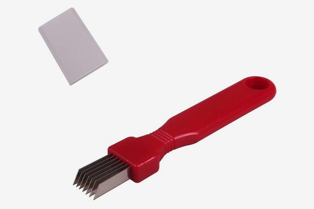 A red scallion shredder