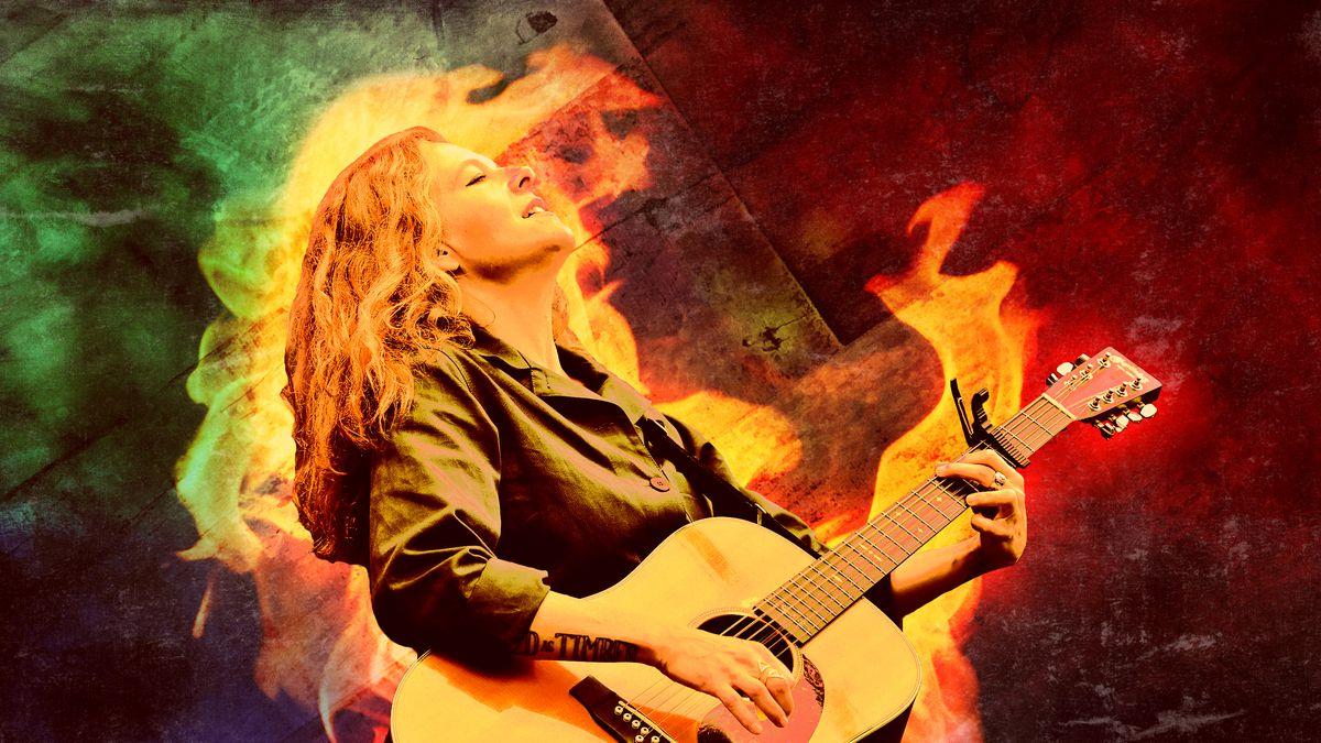 Neko Case playing guitar
