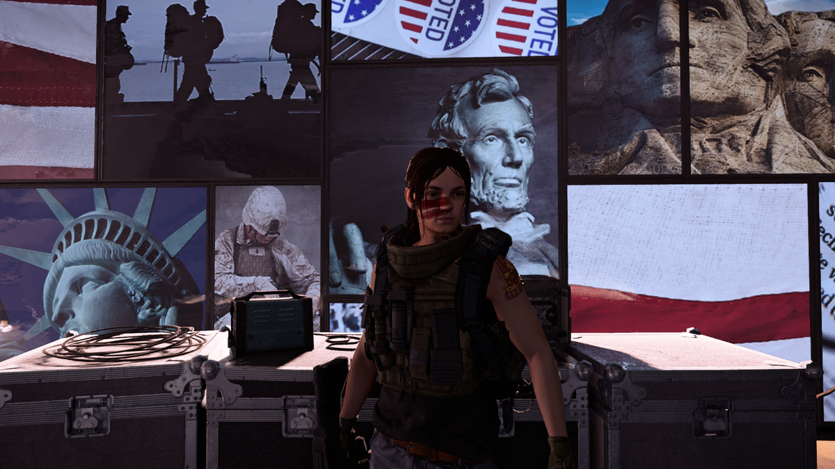 The Division 2 - a player stands in front of a wall of American imagery