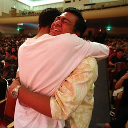 A classmate embraces Siaosi Heimuli, right, after learning he was named Granite School District's Absolutely Incredible Kid during a ceremony at Granite Park Junior High in Salt Lake City on Monday, May 23, 2016.
