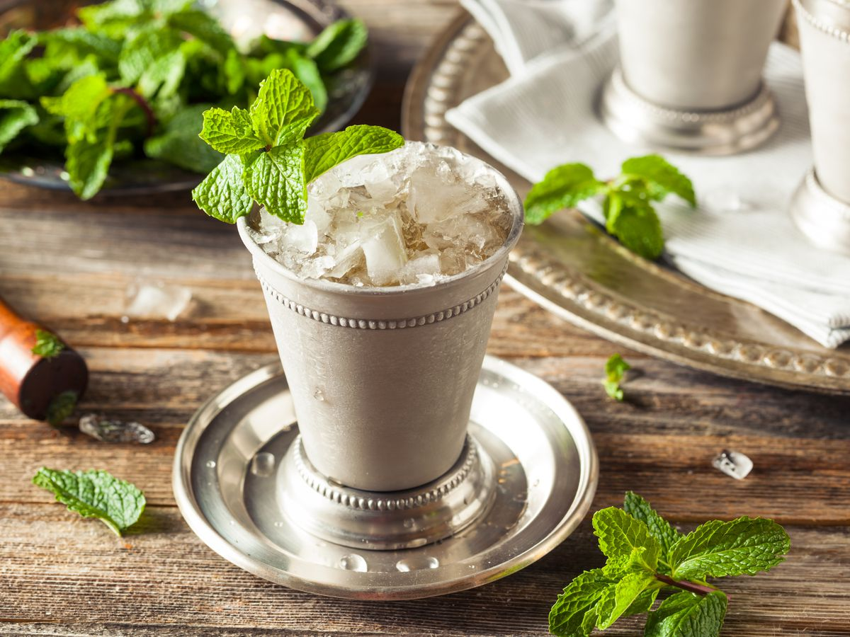 A classic mint julep in its shiny silver cup.