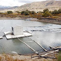 A pump house sits in the middle of the geothermal Crystal Lake in Bluffdale. The pump house distributes the 80 degree water to the Crystal Springs Fisheries. Covers are used on the lake in the winter to help retain heat.