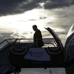 Republican presidential candidate and former Massachusetts Gov. Mitt Romney arrives in West Palm Beach, Fla., for private campaign fundraising events, Thursday, Sept. 20, 2012.
