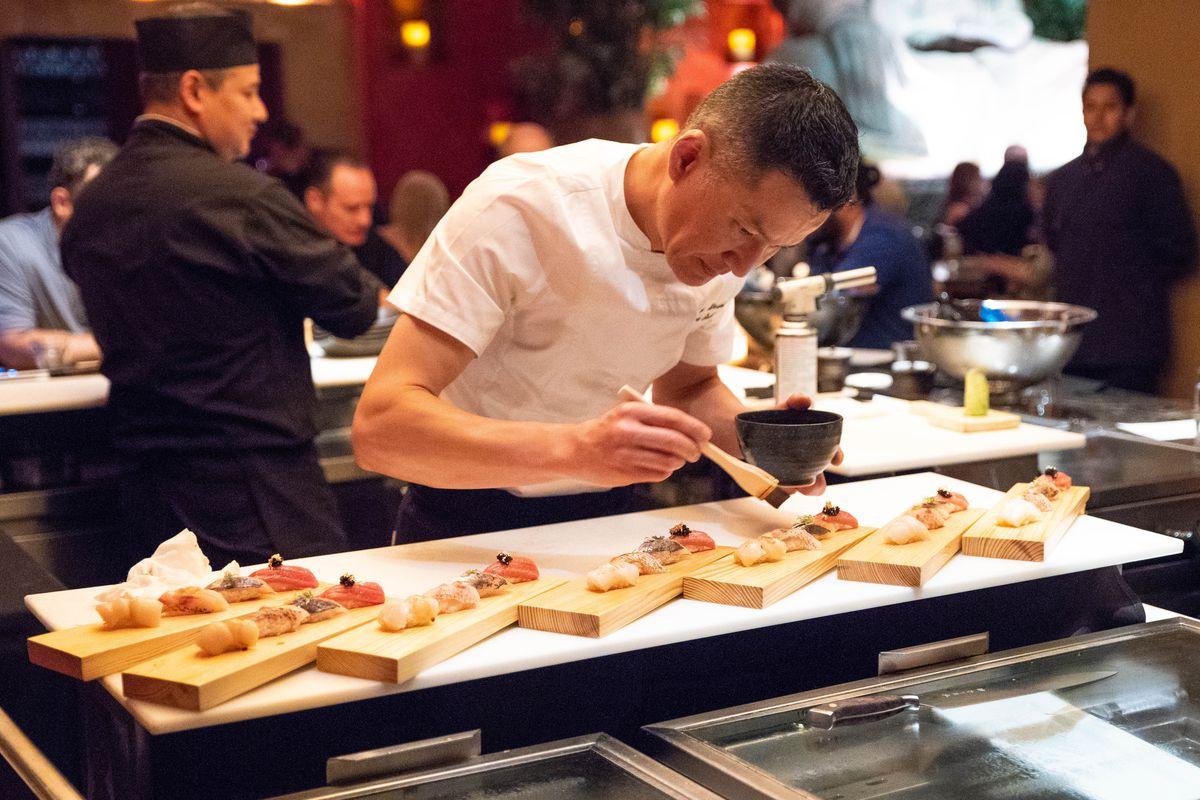 A chef prepares sushi